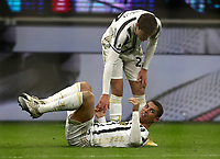 Calcio, Serie A: Inter Milano - Juventus FC , Giuseppe Meazza (San Siro) stadium, in Milan, January 17, 2021.<br /> Juventus' Federico Chiesa (top) helps his teammate Cristiano Ronaldo (bottom) during the Italian Serie A football match between Inter and Juventus at Giuseppe Meazza (San Siro) stadium, January 17,  2021.<br /> UPDATE IMAGES PRESS/Isabella Bonotto