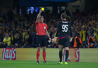 Referee Felix Swayer (GER) issues Goalkeeper Predrag Rajkovic of Maccabi Tel Aviv a yellow card during the UEFA Champions League match between Chelsea and Maccabi Tel Aviv at Stamford Bridge, London, England on 16 September 2015. Photo by Andy Rowland.
