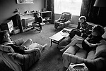 Middle class family watching TV at home, interior of house outside Birmingham 1970s.