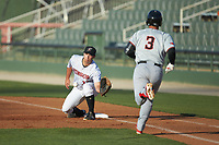 Kannapolis Intimidators first baseman Justin Yurchak (33) reaches for a throw as Yohel Pozo (3) of the Hickory Crawdads hustles down the line at Kannapolis Intimidators Stadium on May 2, 2018 in Kannapolis, North Carolina.  The Intimidators defeated the Crawdads 9-6.  (Brian Westerholt/Four Seam Images)