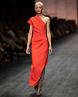 A model wearing a design by Ginger & Smart walks at the Runway 3 show of the 2020 Virgin Australian Melbourne Fashion at the Royal Exhibition Building in Melbourne, Australia. Photo Sydney Low