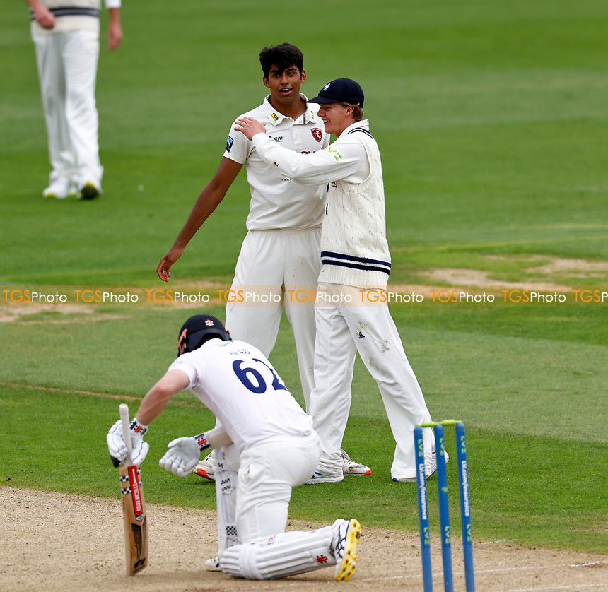 Jas Singh of Kent is congratulated after taking the wicket of Travis Head (foreground) during Kent CCC vs Sussex CCC, LV Insurance County Championship Group 3 Cricket at The Spitfire Ground on 11th July 2021