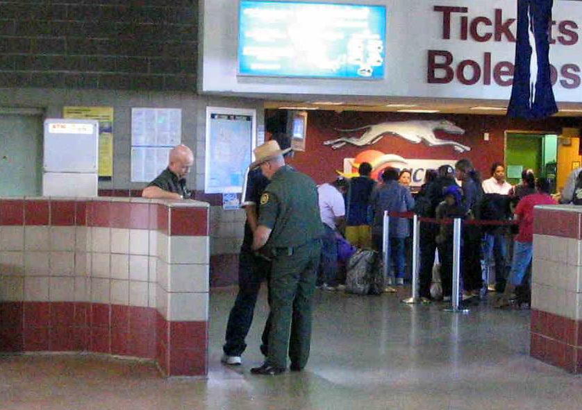 Border Patrol Arresting an Undocumented Immigrant at a Greyhound Bus Station in Phoenix, AZ..Photo by AJ Alexander