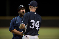 AZL Padres 2 catcher Stephen McGee (34) thanks manager Aaron Levin (56) after a rehab appearance during an Arizona League game against the AZL Padres 1 at Peoria Sports Complex on July 14, 2018 in Peoria, Arizona. The AZL Padres 1 defeated the AZL Padres 2 4-0. (Zachary Lucy/Four Seam Images)