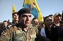 Iraq 2009  A Kurdish Peshmerga  tries to control the crowd of sympathisers who had come to Zakho to show support to 8 PKK guerillas on their way to Turkey .Irak 2009 Un peshmerga kurde essayant de controler la foule des sympathisants du PKK venus supporter des combattants du PKK qui sont en route pour la Turquie ..