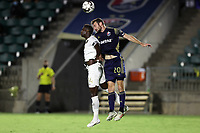 CARY, NC - AUGUST 01: Conor Donovan #20 and Rudolf Mensah #14 challenge for a header during a game between Birmingham Legion FC and North Carolina FC at Sahlen's Stadium at WakeMed Soccer Park on August 01, 2020 in Cary, North Carolina.