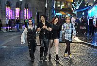 Pictured: People walk down Wind Street in the early hours of New Year's Day. Sunday 01 January 2017<br />Re: Revellers out celebrating the New Year in the pub and club on Wind Street Swansea