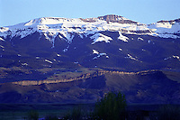 """Carter Mountain divides the South Fork of the Shoshone River on its northern slopes and the Greybull River on its southern slopes. The thin rim of """"wall"""" which graces it's western slopes at the eastern end of the mountain will light up dramatically as the sun sets in the west, particularly in the summers months."""
