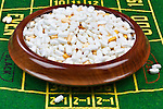 Gambling with Drugs.  Legal drugs represented with roulette wheel.  Conceptual image representing drug culture, medical, insurance, dichotomy, and more.