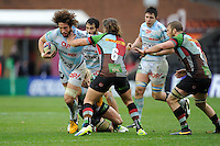 Camille Gerondeau of Racing Metro 92 is tackled by Luke Wallace of Harlequins during the Heineken Cup match between Harlequins and Racing Metro 92 at the Twickenham Stoop on Sunday 15th December 2013 (Photo by Rob Munro)
