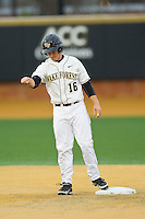 Andrew Williams (16) of the Wake Forest Demon Deacons stands on second base after hitting an RBI double against the Western Carolina Catamounts at Wake Forest Baseball Park on March 26, 2013 in Winston-Salem, North Carolina.  The Demon Deacons defeated the Catamounts 3-1.  (Brian Westerholt/Four Seam Images)