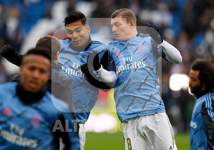 Real Madrid CF's Toni Kroos and Real Madrid CF's Carlos H. Casemiro  warms up before the Spanish La Liga match round 20 between Real Madrid and Granada CF at Santiago Bernabeu Stadium in Madrid, Spain
