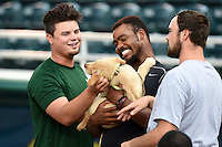 Daytona Tortugas Nick Travieso, El'Hajj Muhammad and Jackson Stephens (L-R) hold a puppy on bark in the park night before a game against the Fort Myers Miracle on June 18, 2015 at Hammond Stadium in Fort Myers, Florida.  Fort Myers defeated Daytona 4-1.  (Mike Janes/Four Seam Images)