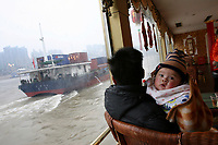 CHINA. Sichuan Province. Chongqing. A baby on a tourist boat on The Yangtze River which is at its lowest level in 150 years as a result of a country-wide drought. Chongqing is a city of over 3,000,000 people, famed for being the capital of China between 1938 and 1946 during World War II. It is situated on the banks of the Yangtze river, China's longest river and the third longest in the world. Originating in Tibet, the river flows for 3,964 miles (6,380km) through central China into the East China Sea at Shanghai.  2008
