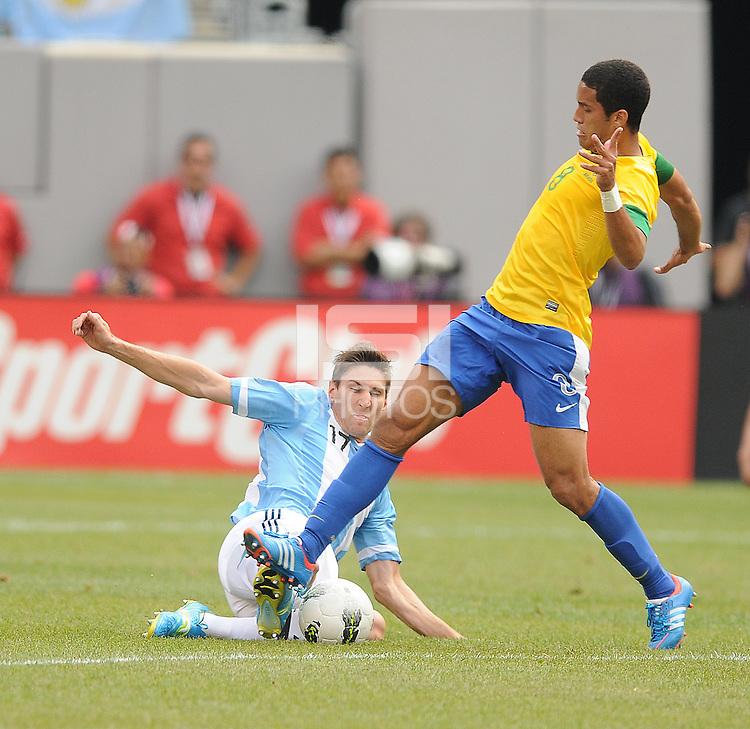 Argentina defender Federico Fernandez (17) goes against  Brazil midfielder Romulo (8) The Argentina National Team defeated Brazil 4-3 at MetLife Stadium, Saturday July 9 , 2012.