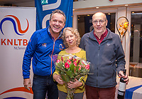 Hilversum, Netherlands, December 3, 2017, Winter Youth Circuit Masters, 12,14,and 16, years, Hans and Gila Langen match controll receivinr flowers and wine from Alex Reijnders (L) <br /> Photo: Tennisimages/Henk Koster