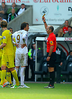 Saturday, 06 October 2012<br /> Pictured L-R: Michu of Swansea sees a yellow card by match referee Mike Dean<br /> Re: Barclays Premier League, Swansea City FC v Reading at the Liberty Stadium, south Wales.