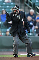 Home plate umpire Joe Byrne makes a call during a game between the Rochester Red Wings and Syracuse Cheifs at Frontier Field on April 25, 2012 in Rochester, New York.  Syracuse defeated Rochester 10-5.  (Mike Janes/Four Seam Images)