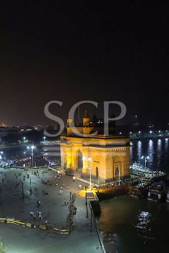 Mumbai, India. The Gateway of India lit up at night from a high viewpoint.
