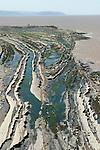 Kilve beach Quantock Hills Somerset UK at low tide showing stratification of rock formation. Stratified rock formation.