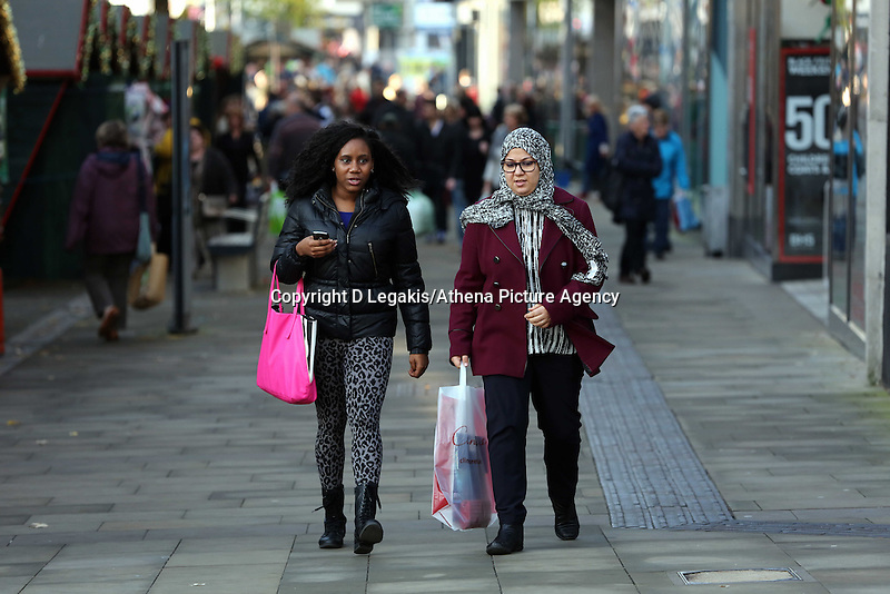 Pictured: Shoppers in Oxford Street, Swansea, south Wales. Friday 28 November 2014<br /> Re: Black Friday pre-Christmas shopping rush all over the UK.