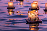On Memorial Day at dusk, lanterns with candle-lit writing to remember and honor deceased loved ones float out to sea at the 15th Annual Lantern Floating Ceremony at Ala Moana Beach Park, Honolulu, O'ahu.