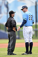 Charlotte Stone Crabs manager Jared Sandberg (22) argues a call with field umpire Joe George during a game against the Fort Myers Miracle on April 16, 2014 at Charlotte Sports Park in Port Charlotte, Florida.  Fort Myers defeated Charlotte 6-5.  (Mike Janes/Four Seam Images)