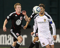 Dax McCarty (10) of D.C. United comes up on David Beckham (23) of the Los Angeles Galaxy during an MLS match at RFK Stadium, on April 9 2011, in Washington D.C.The game ended in a 1-1 tie.