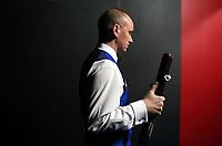CHINA. Beijing. English snooker player Peter Ebdon backstage just before going to play at the China Snooker Open which he won that year. Snooker is a cue sport played on a large table measuring 3.6 metres x 1.8 metres. Originating in India in the late 19th Century where it was invented by British Army officers, the game has been a mainstay in British sport over the past few decades. Recently however, popularity of the sport has declined as the sport struggles to compete with other popular sports. The sport is however flourishing in countries such as China, where it is now the second most popular sport, behind Basketball. In a country where the  players are treated like movie-stars, China may be the great hope for the sports recovery. 2009