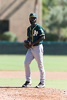 Oakland Athletics relief pitcher Rafael Kelly (61) gets ready to deliver a pitch during an Instructional League game against the Los Angeles Dodgers at Camelback Ranch on September 27, 2018 in Glendale, Arizona. (Zachary Lucy/Four Seam Images)