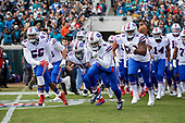 Buffalo Bills, lead by quarterback Tyrod Taylor (5), take the field during introductions before an NFL Wild-Card football game against the Jacksonville Jaguars, Sunday, January 7, 2018, in Jacksonville, Fla.  (Mike Janes Photography)