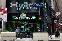 NEW YORK - NEW YORK - MARCH 25: People walk in front of Weed World Store on March 25, 2021 in New York. New York State reach a deal to legalize recreational marijuana, and open a way for a almost $4.2 billion industry that could create  thousands of jobs.. (Photo by Emaz/VIEWpress)