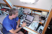 - sailing boat in navigation, chart table....- barca a vela in navigazione, tavolo da carteggio