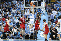 CHAPEL HILL, NC - FEBRUARY 25: Justin Pierce #32 of the University of North Carolina dunks the ball during a game between NC State and North Carolina at Dean E. Smith Center on February 25, 2020 in Chapel Hill, North Carolina.