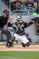 Charlotte Knights catcher Jeremy Dowdy (14) throws the ball back to his pitcher during the game against the Columbus Clippers at BB&T BallPark on May 27, 2015 in Charlotte, North Carolina.  The Clippers defeated the Knights 9-3.  (Brian Westerholt/Four Seam Images)