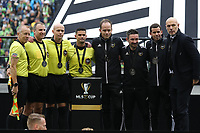 SEATTLE, WA - NOVEMBER 10: Match Officials Corey Rockwell, Rubiel Vazquez, Allen Chapman, Brian Dunn, Cameron Blanchard, Edvin Jurisevic, and Brian Poeschel pose with Professional Referee Organization General Manager Howard Webb after receiving their medals during a game between Toronto FC and Seattle Sounders FC at CenturyLink Field on November 10, 2019 in Seattle, Washington.