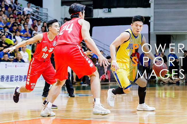 Lau Chi Kin #8 of Winling Basketball Club handles the ball against the SCAA during the Hong Kong Basketball League game between SCAA vs Winling at Southorn Stadium on June 19, 2018 in Hong Kong. Photo by Yu Chun Christopher Wong / Power Sport Images