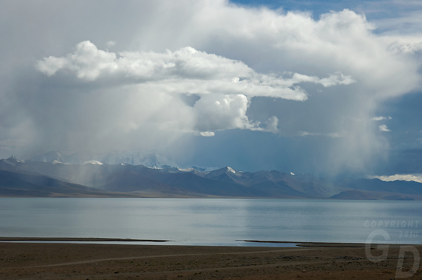 Storm over Lake Namtso, Tibet Lake Namtso which is the highest saltwater lake in the world at an elevation of 4870 meters. The snow-covered Mountain range just behind the lake reach over 7500 meters.