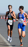 25 MAR 2012 - LOUGHBOROUGH, GBR - Matt Gunby (PACTRAC) (right) turns to check the position of Mark Buckingham (Holmfirth Harriers) during the men's 2012 British Elite Duathlon Championships  at Prestwold Hall Airfield in Prestwold near Loughborough, Great Britain (PHOTO (C) 2012 NIGEL FARROW)
