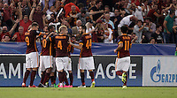 Calcio, Champions League, Gruppo E: Roma vs Barcellona. Roma, stadio Olimpico, 16 settembre 2015.<br /> Roma's Alessandro Florenzi is hidden by teammates' hugs after scoring during a Champions League, Group E football match between Roma and FC Barcelona, at Rome's Olympic stadium, 16 September 2015.<br /> UPDATE IMAGES PRESS/Isabella Bonotto