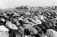 """Iraq. Baghdad. Al Sadr City. Men bend their heads down on the ground for the midday prayer on friday during the month of Moharam which is considerated as one of the most important feast for the Shiism branch of Islam. Muharram is a month of remembrance that is often considered synonymous with the event of Ashura. Ashura, which literally means the """"Tenth"""" in Arabic, refers to the tenth day of Muharram. It is well-known because of historical significance and mourning for the martyrdom of Hussein ibn Ali, the grandson of Muhammad. Shi'a Muslims start the mourning from the 1st night of Muharram and continue for two months and eight days. However the last days are the most important since these were the days where Hussein and his family and followers were killed in the Battle of Karbala which took place on Muharram 10, in the year 61 of the Islamic calendar (October 10, 680). Muharam's month is considerated as one of the most important feast for the Shiism branch of Islam. Shia Islam is the second largest denomination of Islam. The followers of Shia Islam are called Shi'ites or Shias. 20.02.04 © 2004 Didier Ruef ."""