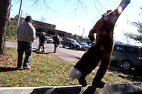 Foxwell Foxcoon balances on a parking block after the end of the Kid's Expo in Poughkeepsie, New York.   Furries are a group of people who identify themselves not as being human but as a walking, talking animal.  For some the lifestyle is complete, animal traits reach into every aspect of life from mundane trips to a grocery store to sexual fantasies.  For others, involvement in the furry fandom is limited to public performances and meet-and-greets.