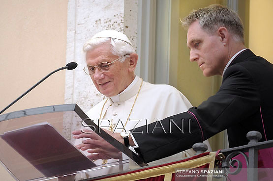 Pope Benedict XVI  Monsignor Georg Gaenswein  leads the Sunday Angelus prayer from the balcony of his summer residence in Castelgandolfo on the outskirts of Rome on July 8, 2012.