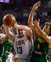 Kevin LOVE (USA) fights for the ball with Simas JASAITIS (Lithuania) and Paulius JANKUNAS (Lithuania)  during the semi-final World championship basketball match against Lithuania in Istanbul, USA-Lithuania, Turkey on Saturday, Sep. 11, 2010. (Novak Djurovic/Starsportphoto.com)