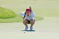 5th September 2021; Toledo, Ohio, USA;  Danielle Kang of Team USA lines up her putt on the 18th hole during the morning Four-Ball competition during the Solheim Cup on September 5th