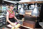 © Joel Goodman - 07973 332324 . 14/08/2015 . Hyde , UK . Staff picking an order . McDonalds' new order screen and waited table service at their branch in Mottram , Hyde . Photo credit : Joel Goodman