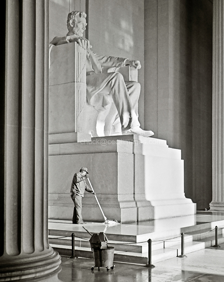 "Washington, D.C., USA.  ""Emancipation Proclamation""; Black American Mops the Floor of the Lincoln Memorial in early Morning."