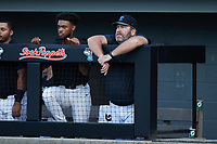 Bluefield Ridge Runners head coach Joe Oliver watches from the dugout during the game against the Burlington Sock Puppets at Burlington Athletic Park on June 8, 2021 in Burlington, North Carolina. (Brian Westerholt/Four Seam Images)