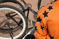 13 SEP 2014 - IPSWICH, GBR - A Sheffield Stars team member waits for his next race during the 2014 British Open Club Cycle Speedway Championships  at Whitton Sports & Community Centre in Ipswich, Great Britain (PHOTO COPYRIGHT © 2014 NIGEL FARROW, ALL RIGHTS RESERVED)