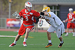 Baltimore, MD - March 3: Midfielder Neill Lewnes #4 of the UMBC Retrievers  checks Attackmen Sam Snow #3 of the Fairfield Stags during the Fairfield v UMBC mens lacrosse game at UMBC Stadium on March 3, 2012 in Baltimore, MD.